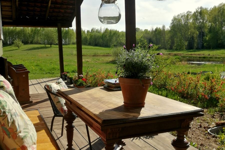 Summer kitchen terrace with view on meadow and forest
