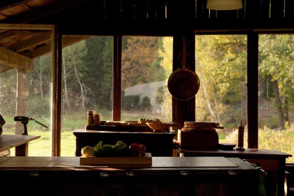 Summer kitchen interior with outdoor view