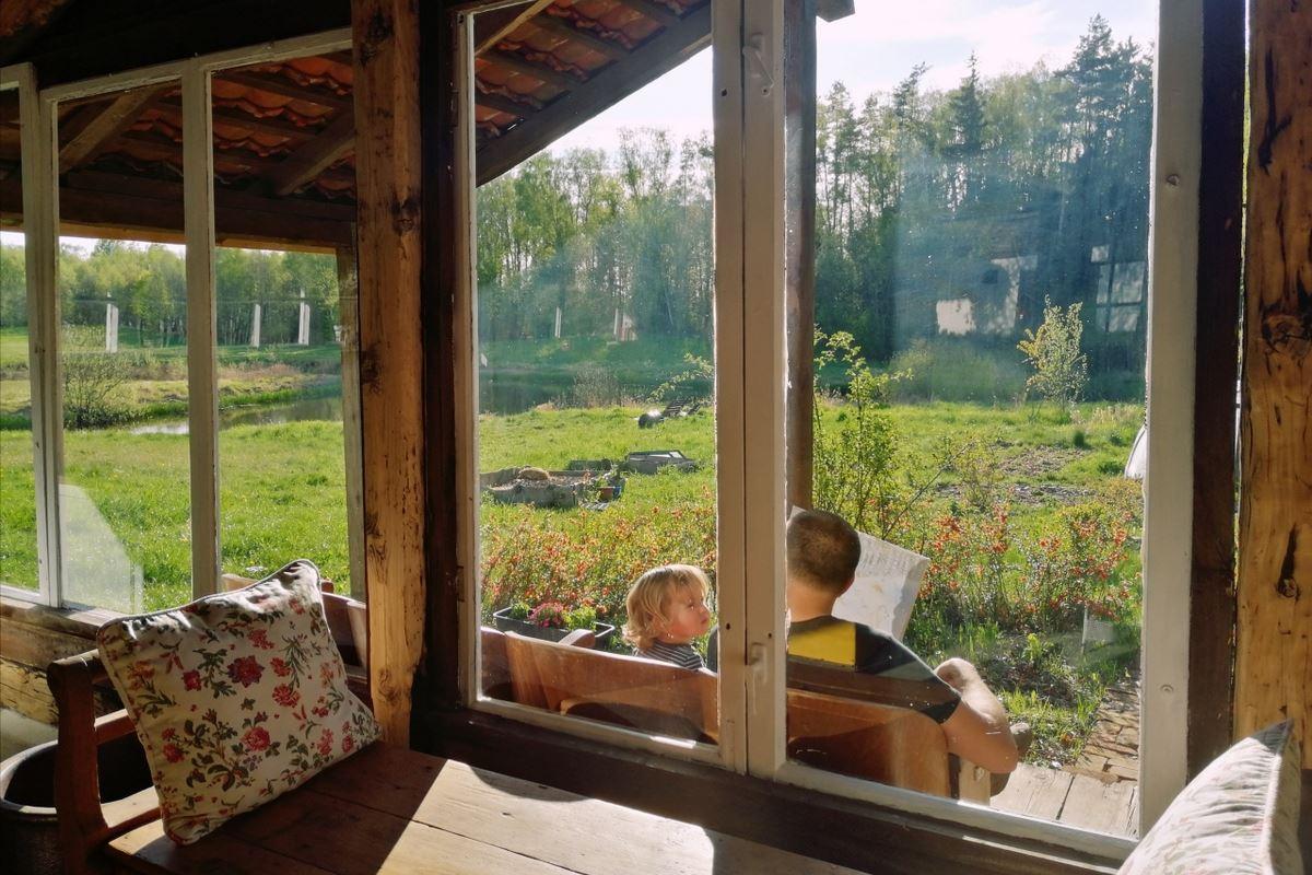 David reading a book to Ernest in Summer kitchen