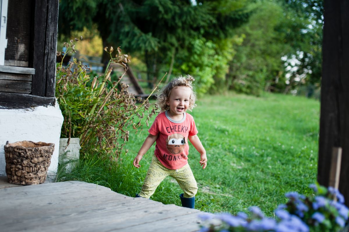 Child playing outside in summer